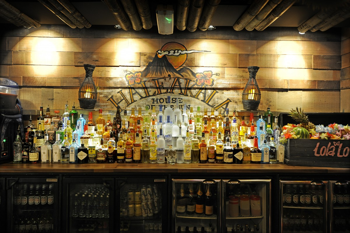 Pele's Bar - The back bar is reclaimed timber with hand painted volcano graphics.